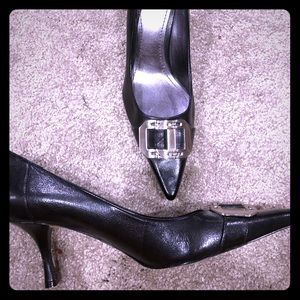 Black heel with silver buckle